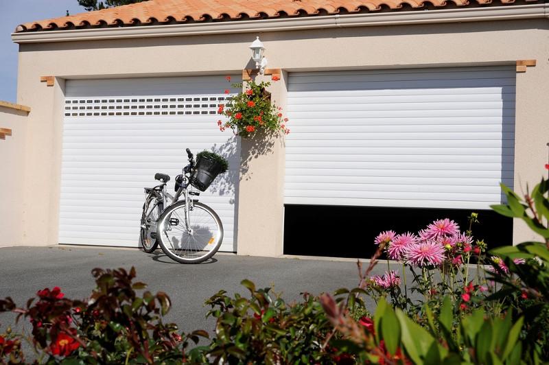 réalisation Portes de garage sectionnelles Iso Store